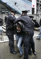 Police arrest anti-poverty protestor during 2010 Olympic Winter games ceremony in Vancouver