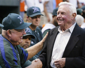 Former Baltimore Orioles manager Earl Weaver greets Tampa Bay Devil rays coach Don Zimmer in Baltimore