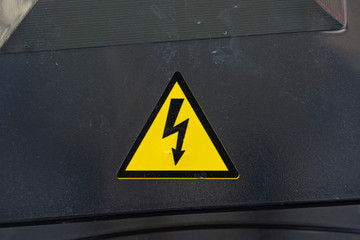 High voltage sign on black surface