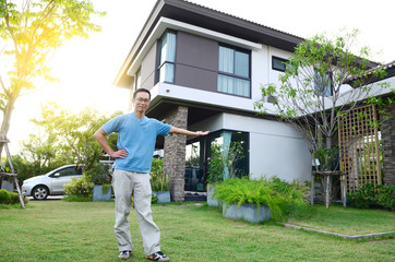 Asian man and his new house