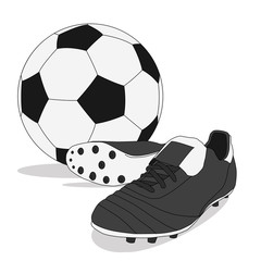 Black and white soccer ball with stud shoes
