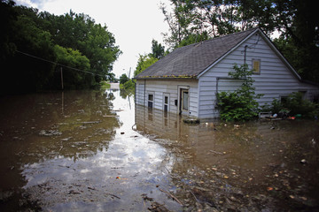 A flooded building partially submerged is pictured in Columbus Junction, Iowa