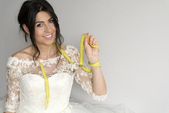 beautiful bride measuring her wedding dress