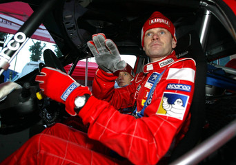FINNISH RALLYING WORLD CHAMPION MARCUS GRONHOLM SITS IN HIS CAR.