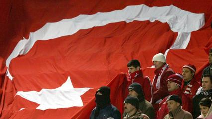 TURKEY'S SOCCER FANS DEJECTEDLY WATCH A GOALLESS GAME BETWEEN TURKEYAND UKRAINE IN IZMIR.