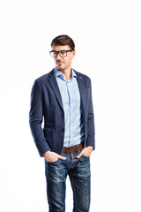 Handsome young man in blue jacket. Studio shot, isolated.