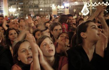 Israelis react following exit polls at Rabin square in Tel Aviv