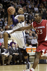 Villanova's Ray shoots under pressure from St. John's Williams during NCAA basketball action in Philadelphia
