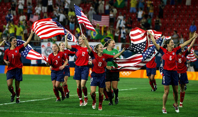 US women soccer team celebrates victory after winning their soccer final match against Brazil in the ...
