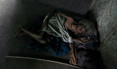 Oraon a tea garden worker lies inside her shack suffering from severe malnutrition in Jalpaiguri