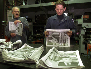 NEWSPRINT WORKER LOOKS AT TEST PRINT FROM LOCAL NEWSPAPER IN SKOPJE.