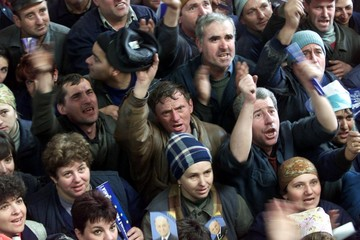 INDUSTRIAL WORKERS CHEER PRESIDENTIAL CANDIDATE ION ILIESCU IN BRASOV.