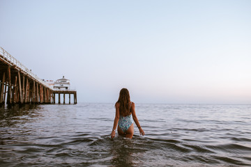 girl walking slowly in the sea