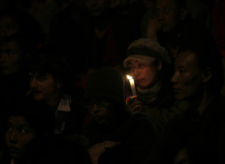 Tibetans-in-exile and sympathisers attend a prayer session to mark the deadline set by China, in Dharamsala