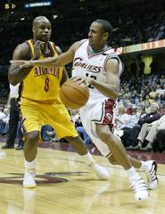 Cleveland Cavaliers Harris drives on Hawks Walker.