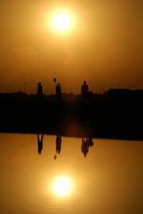 - PHOTO TAKEN 26JAN04 - Colombian Wayuu Indians arrive at the Manaure salt mine at sunrise, in the n..
