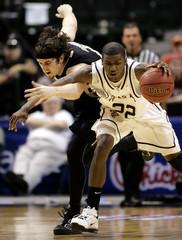 Texas A&M Aggies guard Kirk and Colorado Buffaloes forward Osborn battle for loose ball during NCAA action in Dallas