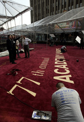 Worker prepares the red carpet arrivals area outside the Kodak Theater in Los Angeles.