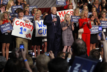 U.S. Republican presidential nominee Senator John McCain (R-AZ) is joined onstage by his daughter Meghan and his wife Cindy at a debate watching party with supporters following the first U.S. presidential debate in Oxford