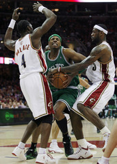 Celtics' Pierce defended by Cavaliers' James and Wallace in third quarter of Game 3 of NBA Eastern Conference semi-finals in Cleveland