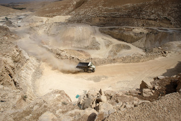 Dump truck drives through quarry near Jerusalem