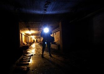 Visitor walks in underground nuclear shelter built in early 195Os in centre of Budapest