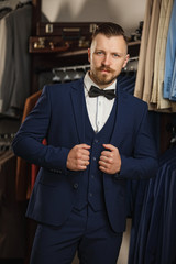 men suit perfect to the last detail. Man posing in brown suit