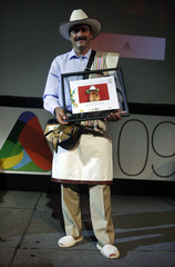 Castaneda who acts as Colombia's fictional coffee icon Juan Valdez in advertisements for Colombia's National Federation of Coffee Growers, poses after being awarded with the first Ibero-American Hall of Fame prize in Buenos Aires