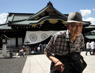 Elderly man visits Yasukuni Shrine, a shrine for war dead seen by many in Asia as symbol of Japan's past militarism, in Tokyo
