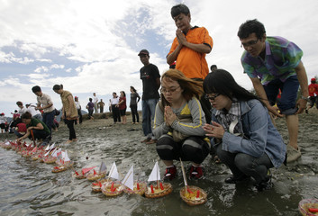 Indonesians Buddhists pray and release offerings to the sea at Uleelheu beach, Banda Aceh