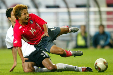 SOUTH KOREA'S LEE FALLS OVER GERMANY'S BALLACK IN THEIR WORLD CUPSEMI-FINAL MATCH IN SEOUL.