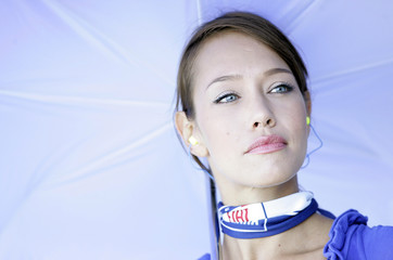 An umbrella girl looks on during the second free practice session for the San Marino Grand Prix at Misano