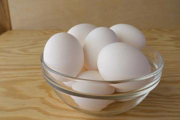 Eggs on wood background