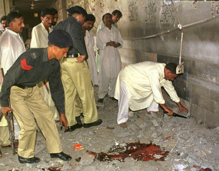 POLICE EXAMINE THE SITE OF A BOMB EXPLOSION IN LAHORE.