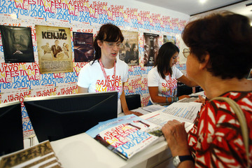 People buy tickets at the box office of the Sarajevo Film Festival in Sarajevo