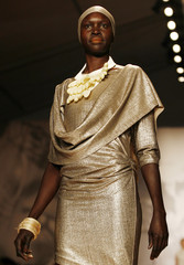 Model Alek Wek presents a creation from the Ports 1961 Spring 2008 collection during New York Fashion Week