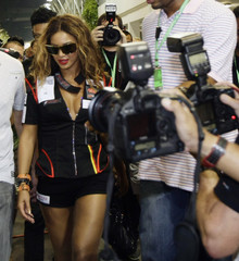 U.S. musician Beyonce is photographed by the media during the Singapore F1 Grand Prix at the Marina Bay street circuit