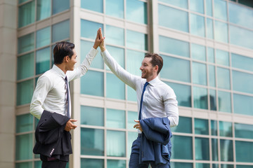 Two Happy Adult Business Men High Fiving