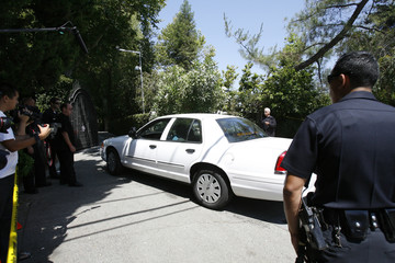 A Los Angeles County Coroner's office vehicle arrives at the Jackson family home in Encino