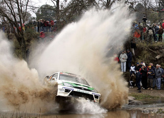 Perez Companc of Argentina drives his Ford Focus through water during Argentine Rally in Cordoba.