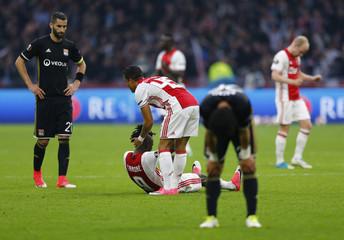 Ajax's Bertrand Traore and Kasper Dolberg celebrate after the match