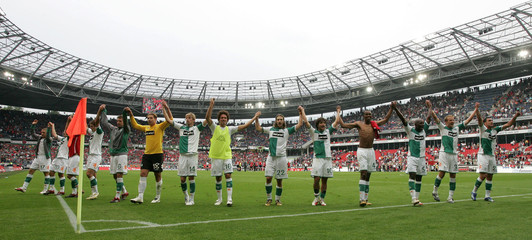 Players of Werder Bremen acknowledge their fans after defeating Hannover 96 in German Bundesliga soccer match in Hanover