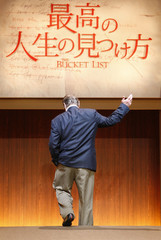 """Actor Jack Nicholson walks off the stage after a news conference to promote his movie """"The Bucket List"""" in Tokyo"""