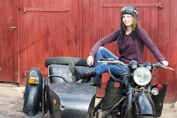 Photo of girl on a vintage motorbike in pilot cap