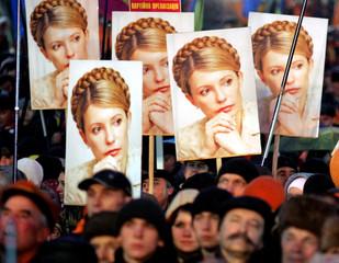 Ukrainian demonstrators hold a portraits of sacked Prime Minister Tymoshenko during a rally in Kiev