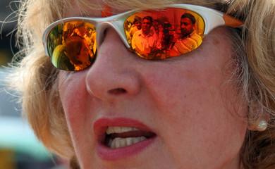 Migrants reflected on sunglasses of Baroness Walmsley near Jammu