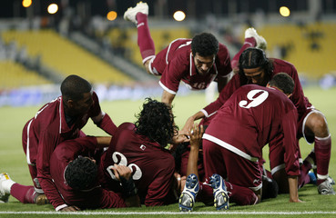 Qatar players celebrate after scoring against Iran during their 9th International Friendship Tournament in Doha