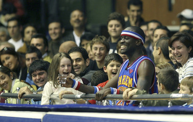 Kevin Daley of Harlem Globetrotters sits among spectators during exhibition game with NY Nationals in Istanbul