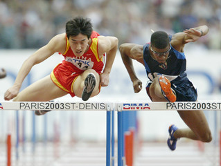 CHINA'S XIANG LIU HURDLES NEXT TO TERRENCE TRAMMELL OF THE U.S. IN THEFIRST ROUND OF THE MEN'S 110 ...