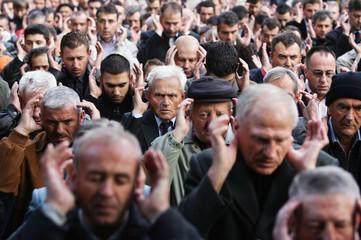 Bosnian Muslims pray outside Begova mosque in the capital Sarajevo